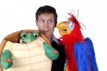 Tim with turtle and parrot puppet